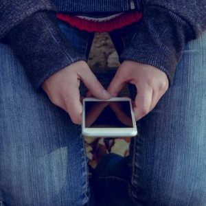 phone in the hands of a teenager