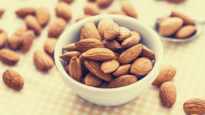a bowl of almonds surrounded by almonds