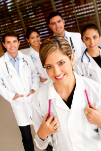 Female doctor surrounded by a group of doctors
