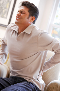 Man grabbing his lower back in pain