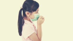 child with a protective mask
