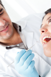 dentist treating a female patient