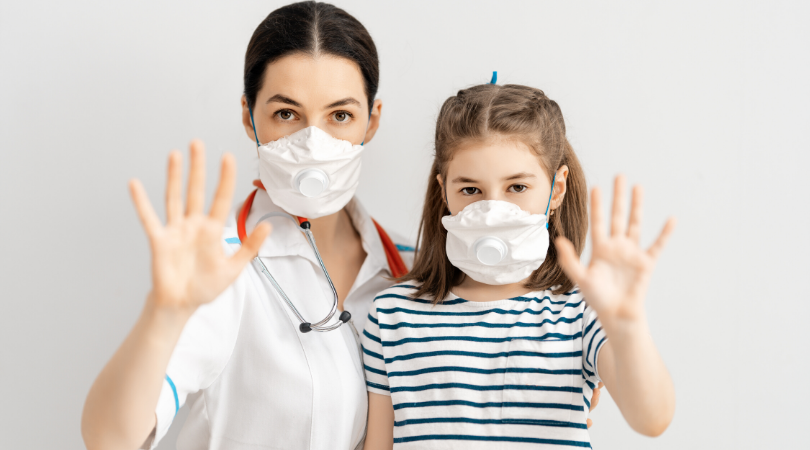 Doctor in mask with vaccine
